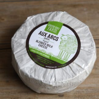 Try Green Dirt Farm's famous blended cow and sheep milk cheese similar to gruyere or gouda, Aux Arcs.
