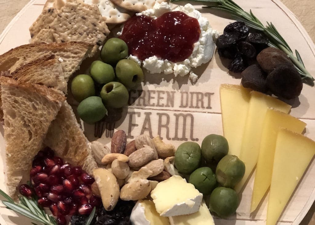 Pair Green Dirt Farm sheep cheese with preserves and olives for the perfect cheese board.